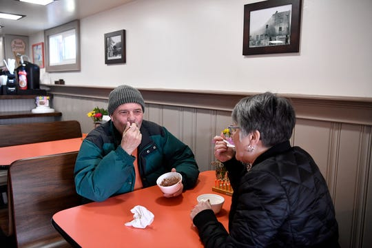 Steve and Vickie Dixon of York enjoy some ice cream at The Haines Shoe House which opened for the season on the first day of spring, Wednesday, March 20, 2019. John A. Pavoncello photo