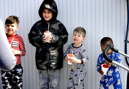 Kassy Theroux lines her sons up for a photo after getting their free Italian ice at Rita's in the Crossroads Shopping Center in York Wednesday, March 20, 2019. The boys are, from left, Lincoln, 5; Michael, 7; Andrew, 3, and Callan, 1. Rita's annually sponsors an Italian ice giveaway on the first day of spring. Bill Kalina photo