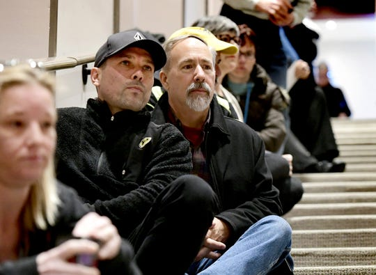 Richard Hernandez, left, and Tim Hirneisen, of Lake Meade, Adams County, take a seat on the steps in the packed auditorium during Lt. Gov. John Fetterman's statewide listening tour Tuesday, March 19, 2019. Fetterman is holding a series of town hall meetings to hear residents' opinions on legalized recreational marijuana. Over 200 attended the event at DeMeester Recital Hall at York College. Bill Kalina photo