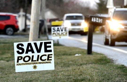 Signs supporting the service of Southwestern Regional Police appear along a road in Stoverstown Tuesday, March 19, 2019. In October, supervisors submitted their intent to abandon the service of the by the end of 2019, citing rising costs as the reason behind the departure. Bill Kalina photo