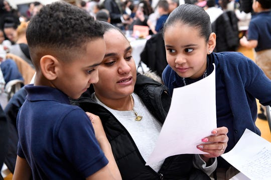 "Jeanna Rodreguiz reads an ""I Believe"" letter from her children Peter, 8 at left, and Ananily, 6, during the Lincoln Charter School Muffins with Mom program, Wednesday, March 20, 2019.
