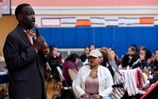 Principal Dr. Leonard S. Hart shares his story of being born to a teenage single mother in Baltimore, passing through the foster system and returning to his mother to nearly 400 mothers attending the Lincoln Charter School Muffins with Mom program, Wednesday, March 20, 2019.John A. Pavoncello photo