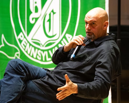 "In this file photo from March 19, 2019, Lt. Gov. John Fetterman acts as a moderator while people voice their opinion about the legalization of marijuana at York College. Fetterman was there as part of a statewide listening tour. He said he views news releases that include mugshots for marijuana possession as public shaming. ""The internet is forever. When you float that publicly, you're harming that person long after any kind of criminal punishment — and something as silly as marijuana prohibition,"" Fetterman said. ""It's insult to injury."""