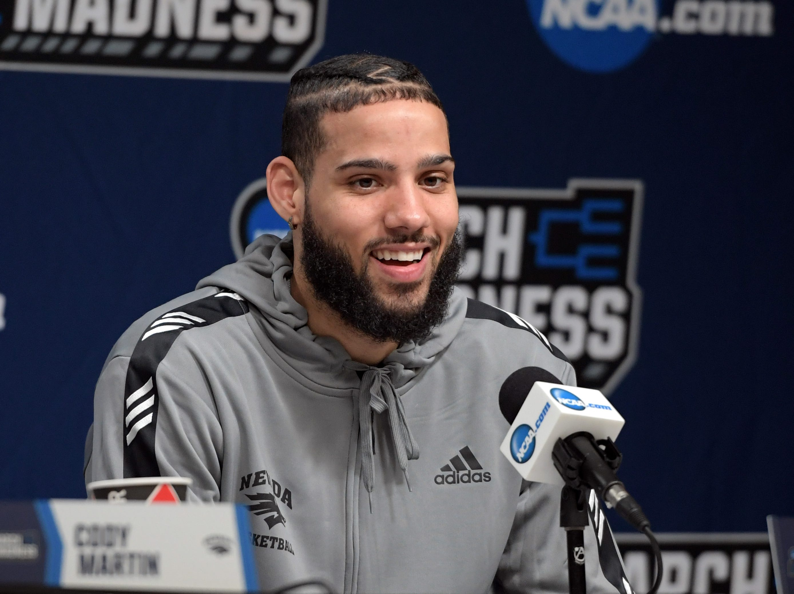 Mar 20, 2019; Des Moines, IA, USA; Nevada Wolf Pack forward Caleb Martin (10) speaks in a press conference during practice before the first round of the 2019 NCAA Tournament at Wells Fargo Arena. Mandatory Credit: Steven Branscombe-USA TODAY Sports
