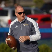 Hug hired Mike Gravier as the school's next football coach