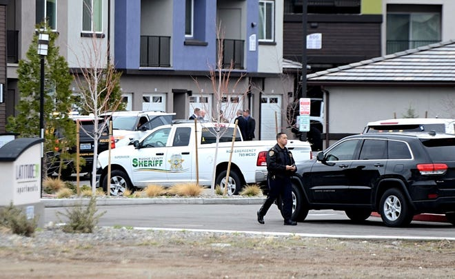 Law enforcement officers respond to a South Reno apartment complex following an officer-involved shooting that occurred on Wednesday, March 20, 2019. The Reno police officer and suspect were both injured and hospitalized.