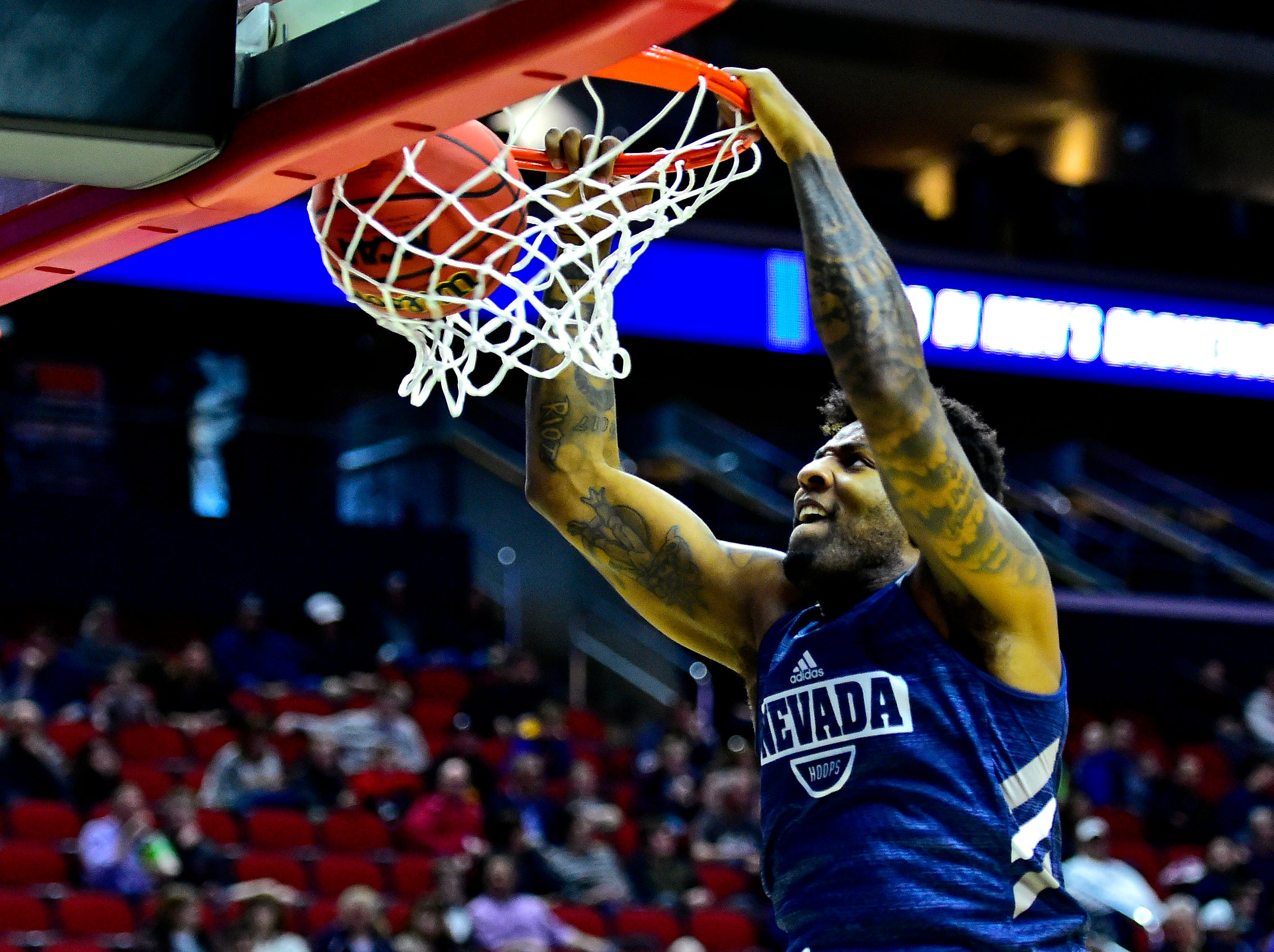 Mar 20, 2019; Des Moines, IA, USA; Nevada Wolf Pack forward Jordan Caroline (24) dunks the ball during practice before the first round of the 2019 NCAA Tournament at Wells Fargo Arena. Mandatory Credit: Jeffrey Becker-USA TODAY Sports