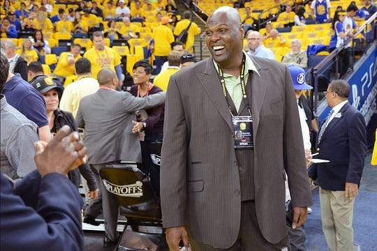 Colgate graduate Adonal Foyle played 10 seasons with the Golden State Warriors and now works in the team's community relations department.