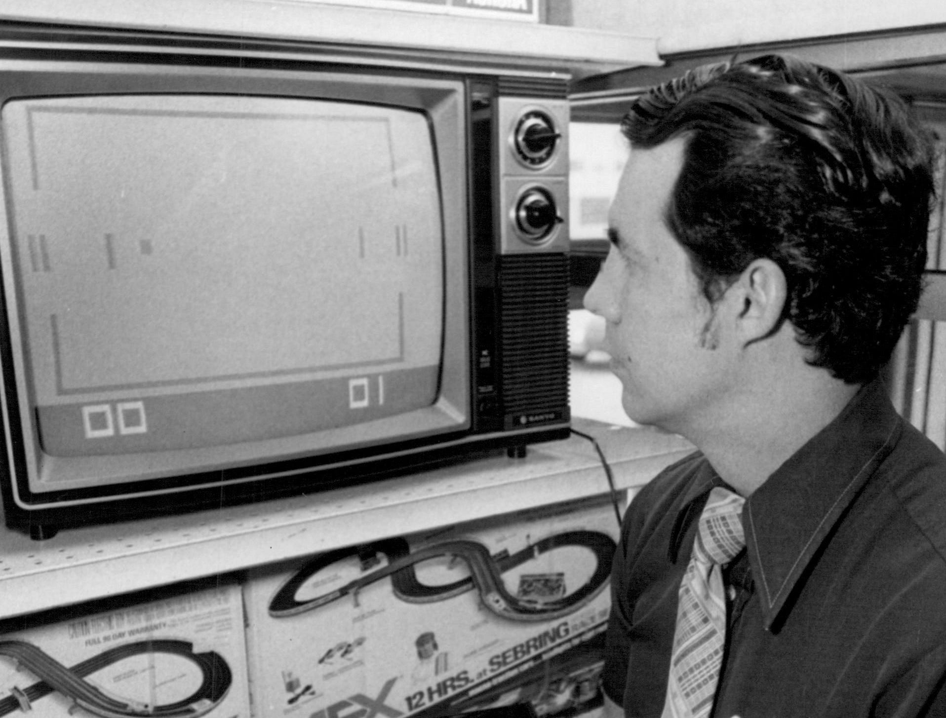In this photo from 1977, Charlie Rabidoux demonstrates a video game at Marjax.
