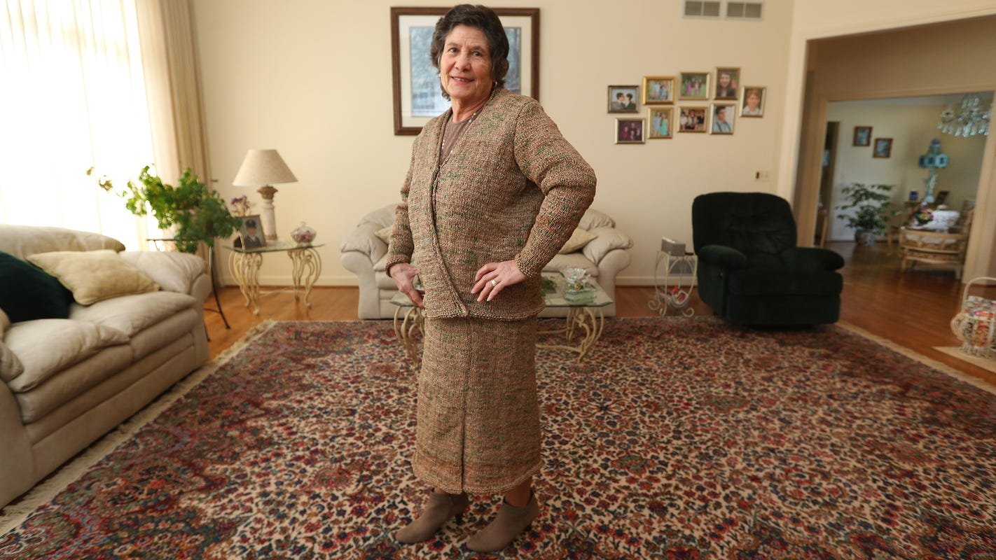 NY woman knits suit, purse using hundreds of repurposed
