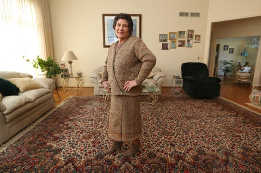 Rosa Ferrigno of Greece spent about two months making a woman's suit from more than 300 plastic Wegmans bags. Here she wears it (with color-coordinating boots).