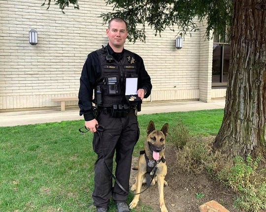 Anderson police officer Tyler Finch with K-9 Chance.