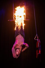 """Escape artist and knife thrower Jonathan Goodwin performs with """"The Illusionists: Live from Broadway"""" on Tuesday in Redding."""
