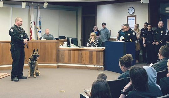 Anderson police officer Tyler Finch, left, and K-9 Chance attend Tuesday night's Anderson City Council meeting where Chance was awarded a Medal of Valor.