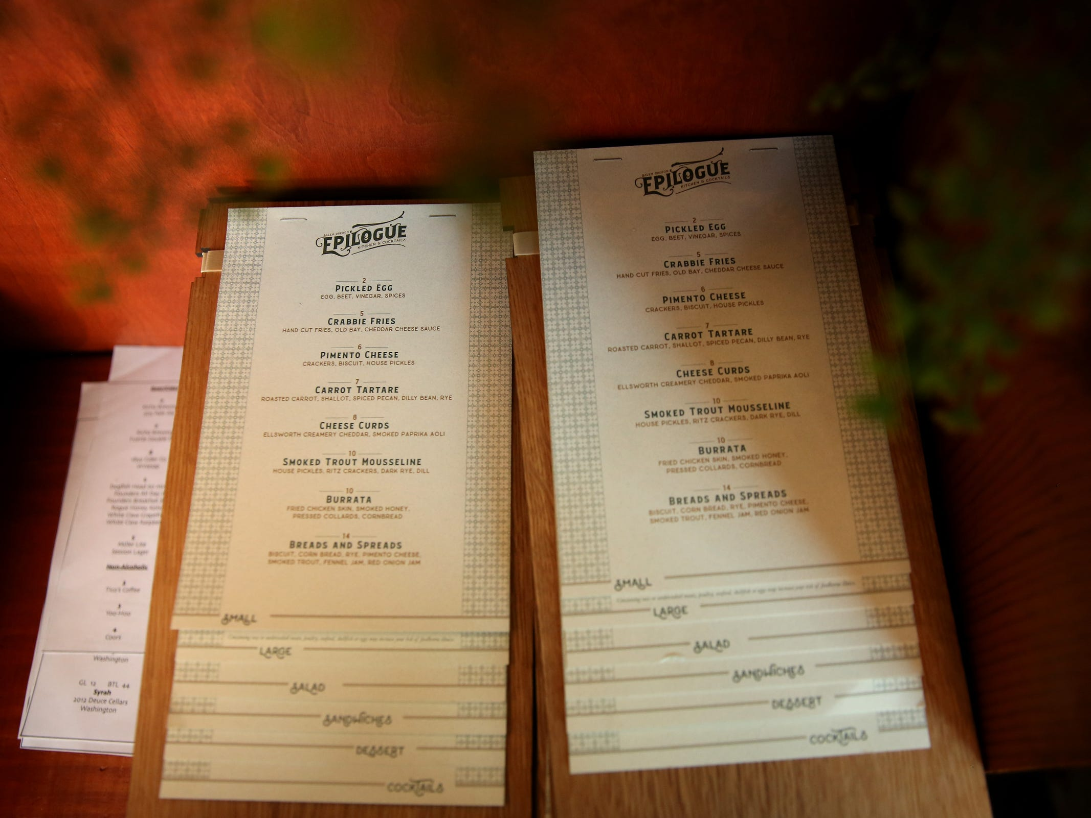 Menus are ready at Epilogue Kitchen & Cocktails in Salem on March 20, 2019. The restaurant opens in downtown Salem on Friday.