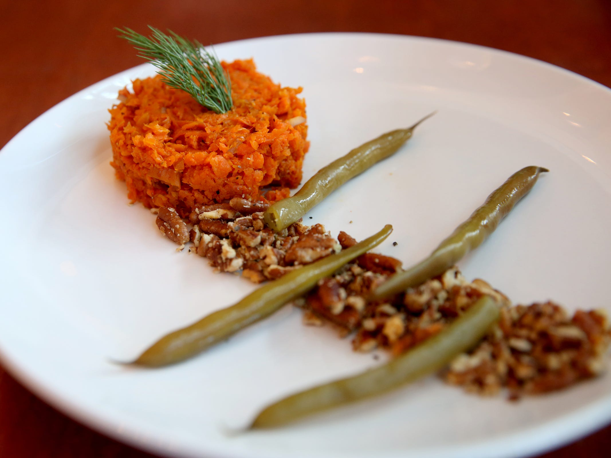 The carrot tartare with roasted carrot, shallot, spiced pecans and dilly beans at Epilogue Kitchen & Cocktails in Salem on March 20, 2019. The restaurant opens in downtown Salem on Friday.