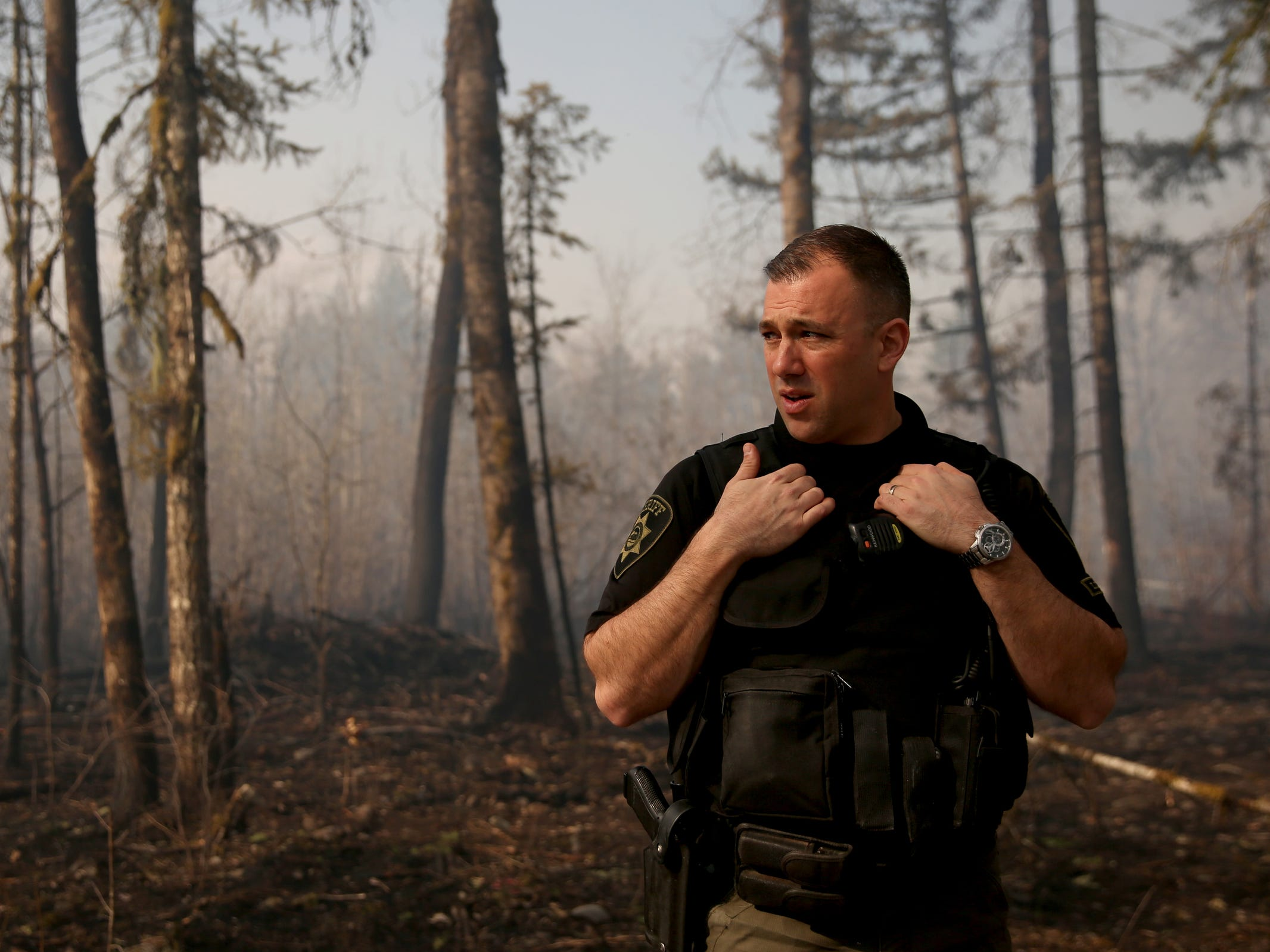 Lt. Chris Baldridge with Marion County Sheriff's Office patrols the North Santiam State Recreation Area as a wildfire that began Tuesday continues to burn in the North Santiam State Recreation Area in near Lyons on March 20, 2019. The fire has forced evacuations in Marion and Linn counties.