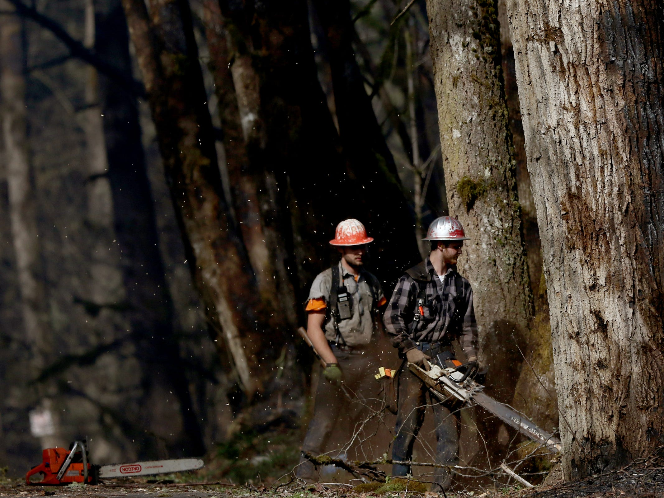 A fire crew patrols the North Santiam State Recreation Area as a wildfire that began Tuesday continues to burn in the North Santiam State Recreation Area in near Lyons on March 20, 2019. The fire has forced evacuations in Marion and Linn counties.