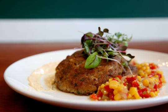 Crab cakes with blue crab, Ritz crackers, Old Bay remoulade, corn relish and micro greens at Epilogue Kitchen & Cocktails in Salem on March 20, 2019. The restaurant opens in downtown Salem on Friday.