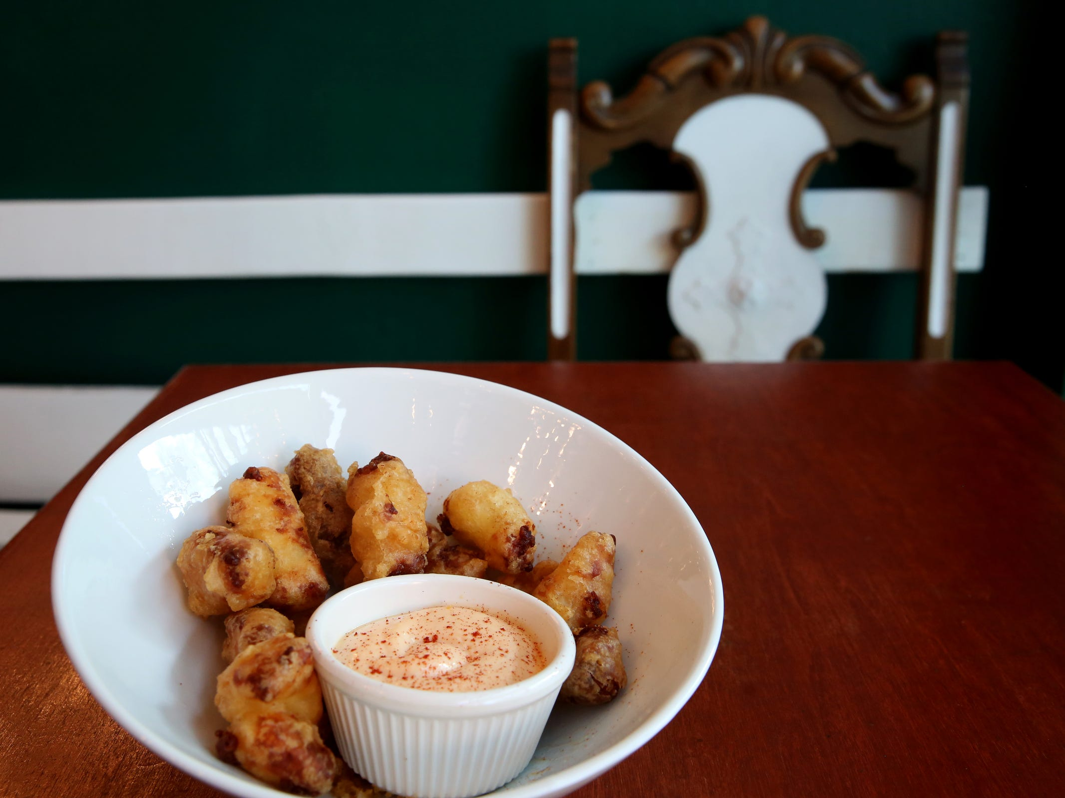 Cheese curds with Ellsworth Creamery cheddar and smoked paprika aioli at Epilogue Kitchen & Cocktails in Salem on March 20, 2019. The restaurant opens in downtown Salem on Friday.