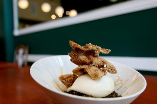 The burrata small plate with fried chicken skins, smoked honey, pressed collards at Epilogue Kitchen & Cocktails in Salem on March 20, 2019. The restaurant opens in downtown Salem on Friday.