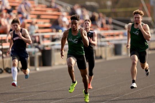 West Salem's Jamal McMurrin, center, leads the boys 100 meter dash in the West Salem vs. Monroe vs. Sprague track and field meet at Sprague High School in Salem on March 19, 2019.