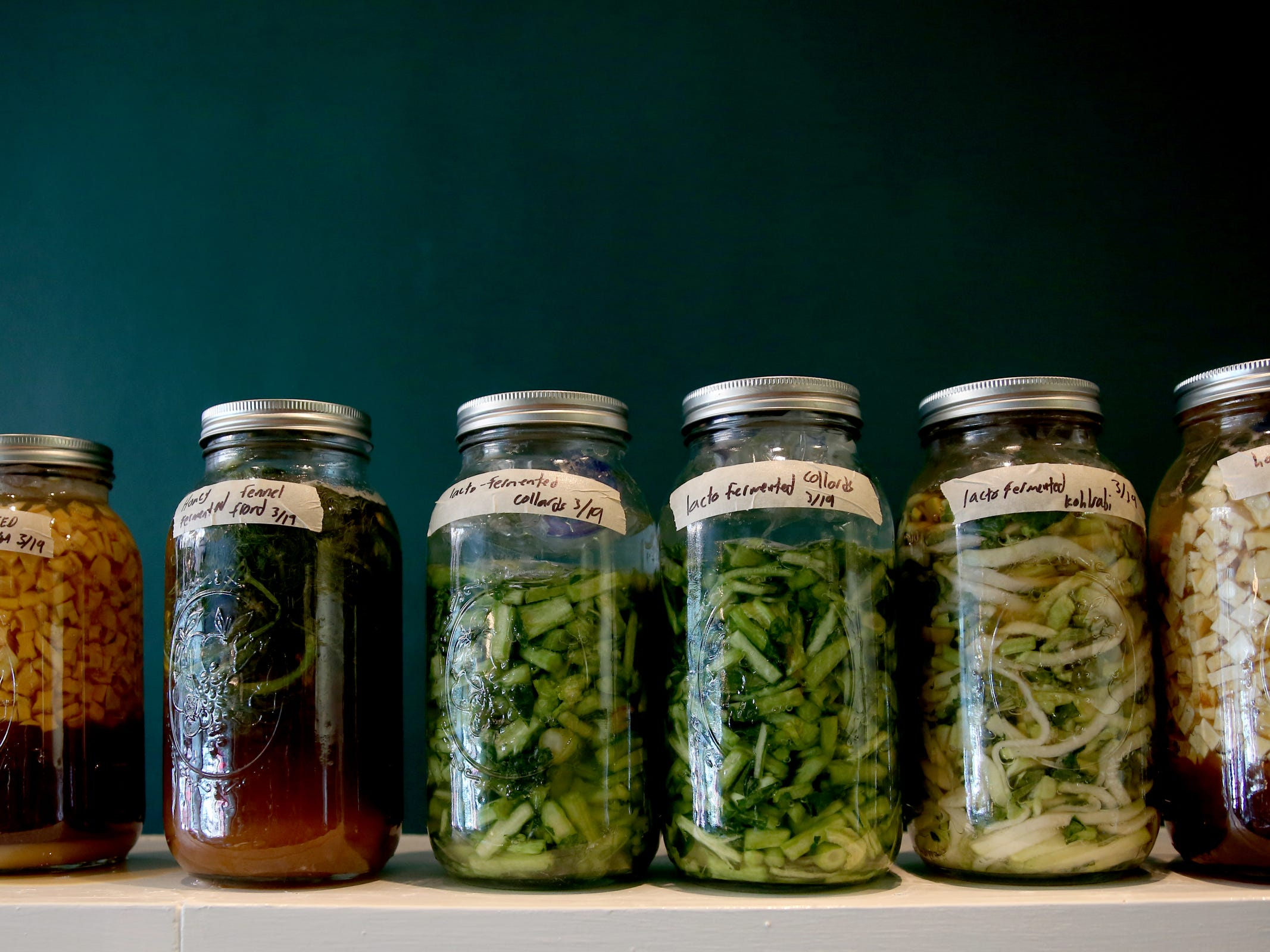 Various vegetables ferment in jars at Epilogue Kitchen & Cocktails in Salem on March 20, 2019. The restaurant opens in downtown Salem on Friday.
