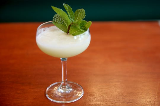 A Rumspringa cocktail with cream of coconut, coconut rum, light rum, gin and mint at Epilogue Kitchen & Cocktails in Salem on March 20, 2019. The restaurant opens in downtown Salem on Friday.