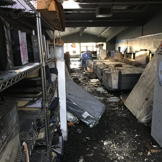 A photo shows damage to the interior of Mattress World Northwest at 618 Lancaster Dr. NE after firefighters responded March 16, 2019 to a fire at the location.