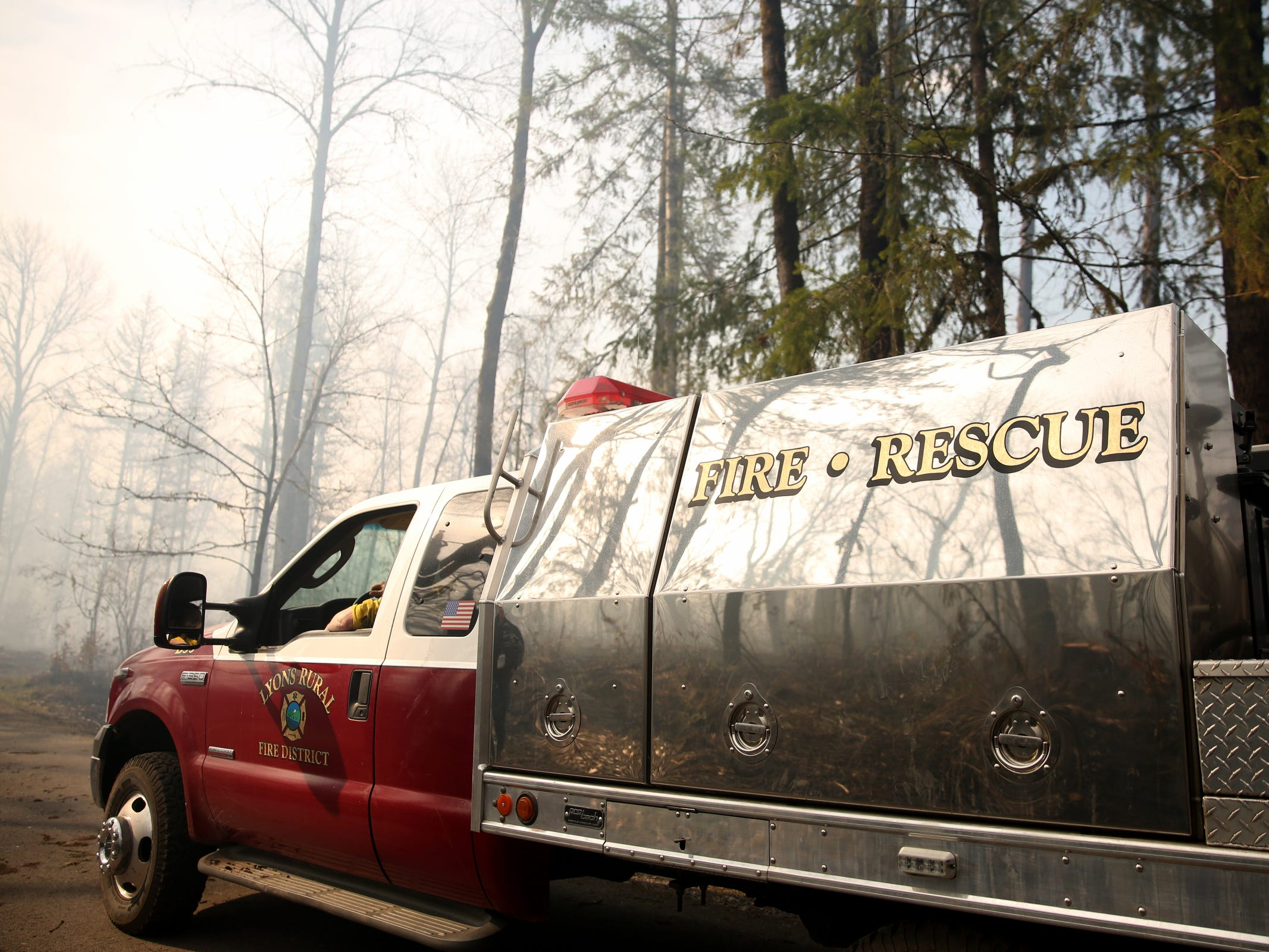 The Lyons Rural Fire District patrols the North Santiam State Recreation Area as a wildfire that began Tuesday continues to burn near Lyons on March 20, 2019. The fire has forced evacuations in Marion and Linn counties.