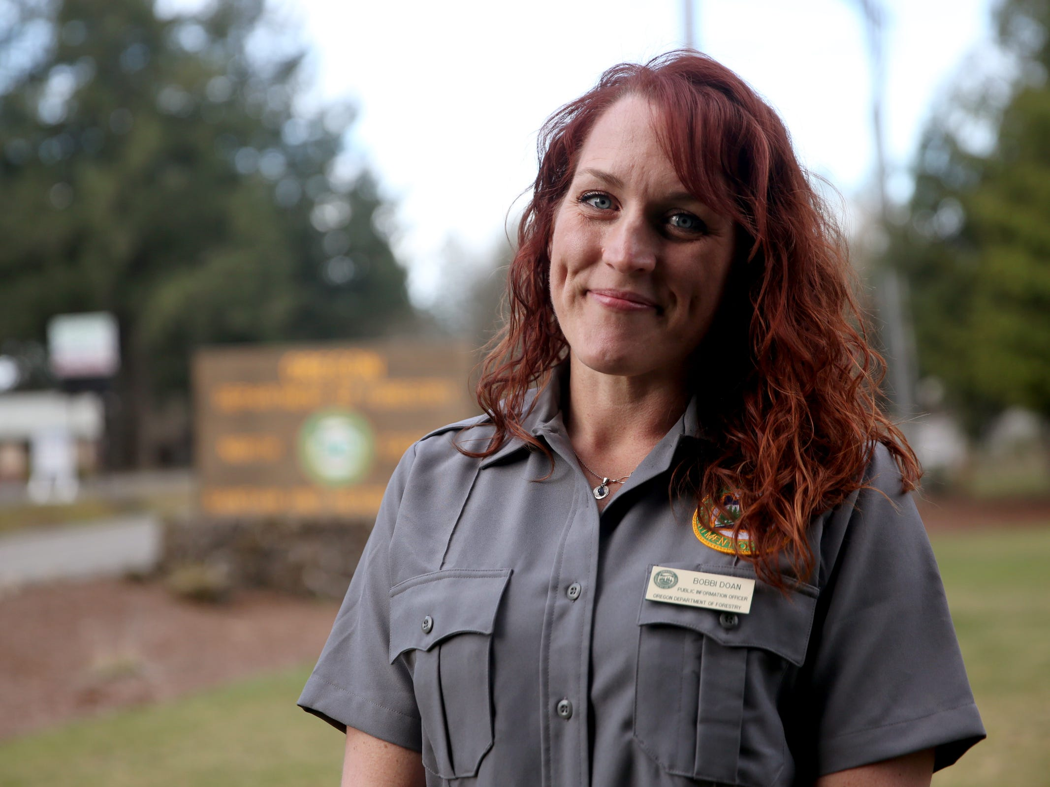 Bobbi Doan a public information officer with the Oregon Department of Forestry stands for a photo at the ODF Santiam Unit office as a wildfire that began Tuesday continues to burn in the North Santiam State Recreation Area in near Lyons on March 20, 2019. The fire has forced evacuations in Marion and Linn counties.