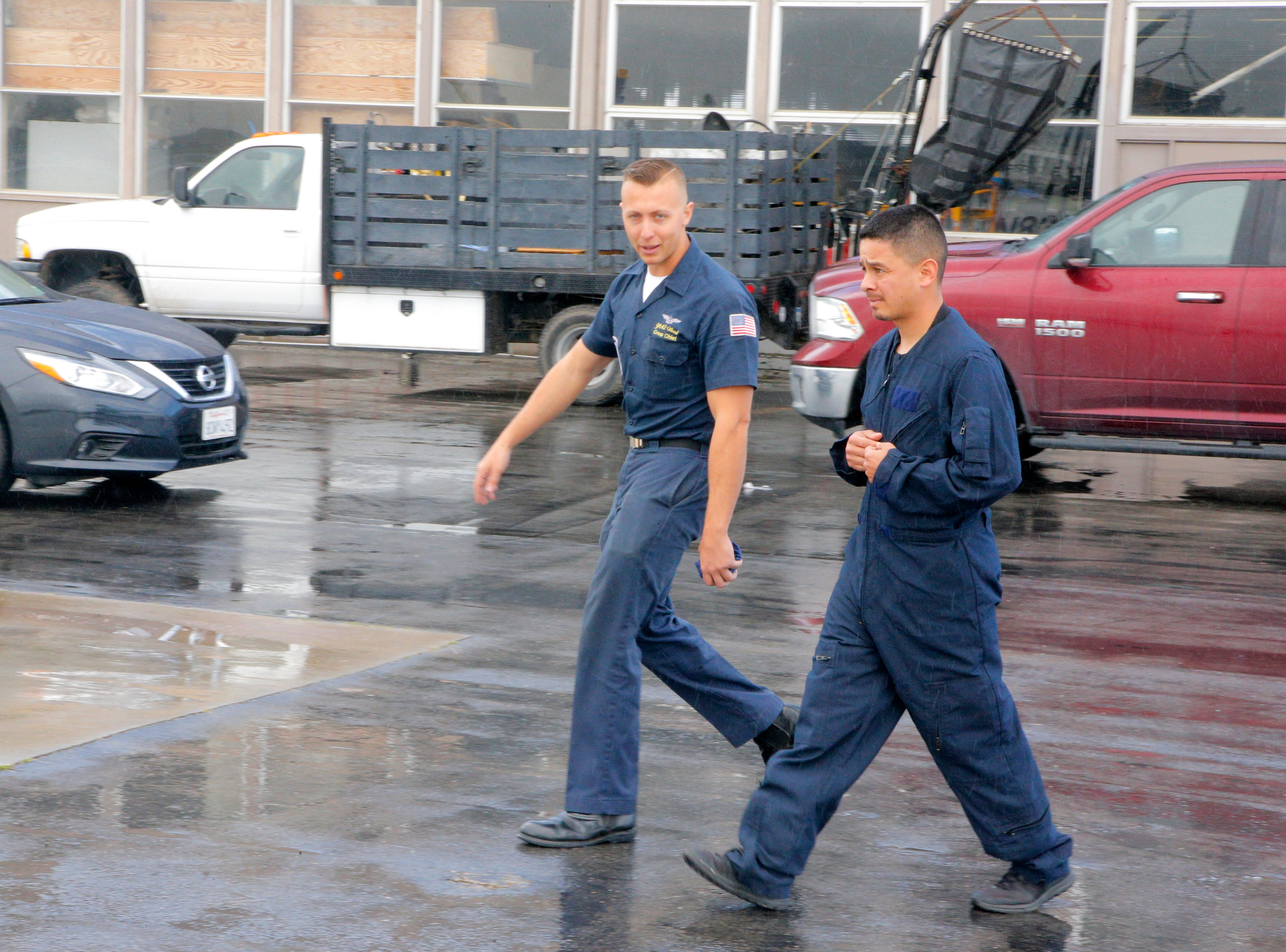 Salinas police officer Daniel Garcia (right) walks with U.S. Navy Petty Officer Kyle Wood to a jet fighter for a ride with the Blue Angels March 20, 2019, in anticipation of the California International Airshow Salinas