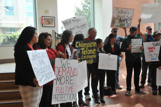 Demonstrators gathered at a March 20, 2019 press conference at the Monterey County Government Center to highlight findings in a UCLA report on the role of county agricultural commissioners in reducing toxic exposure.
