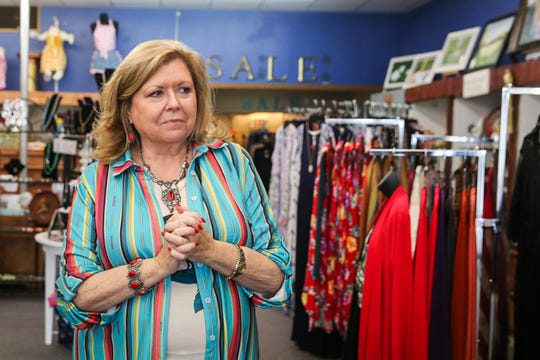 Patti Pool walks through her shop Friday, March 15, 2019,  Frizzled Feathers Boutique, 2006 W. Beauregard Ave.