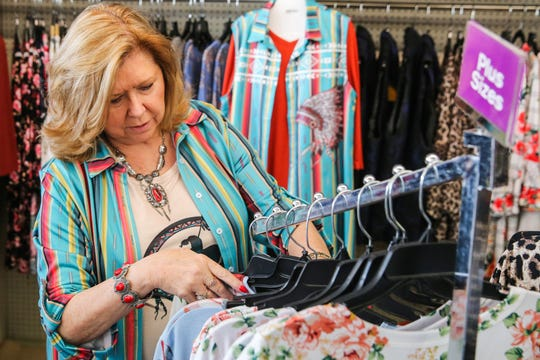 Patti Pool helps a customer Friday, March 15, 2019,  Frizzled Feathers Boutique, 2006 W. Beauregard Ave.