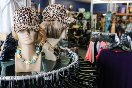 Fun hats and other accessories are featured at Frizzled Feathers Boutique, 2006 W. Beauregard Ave.