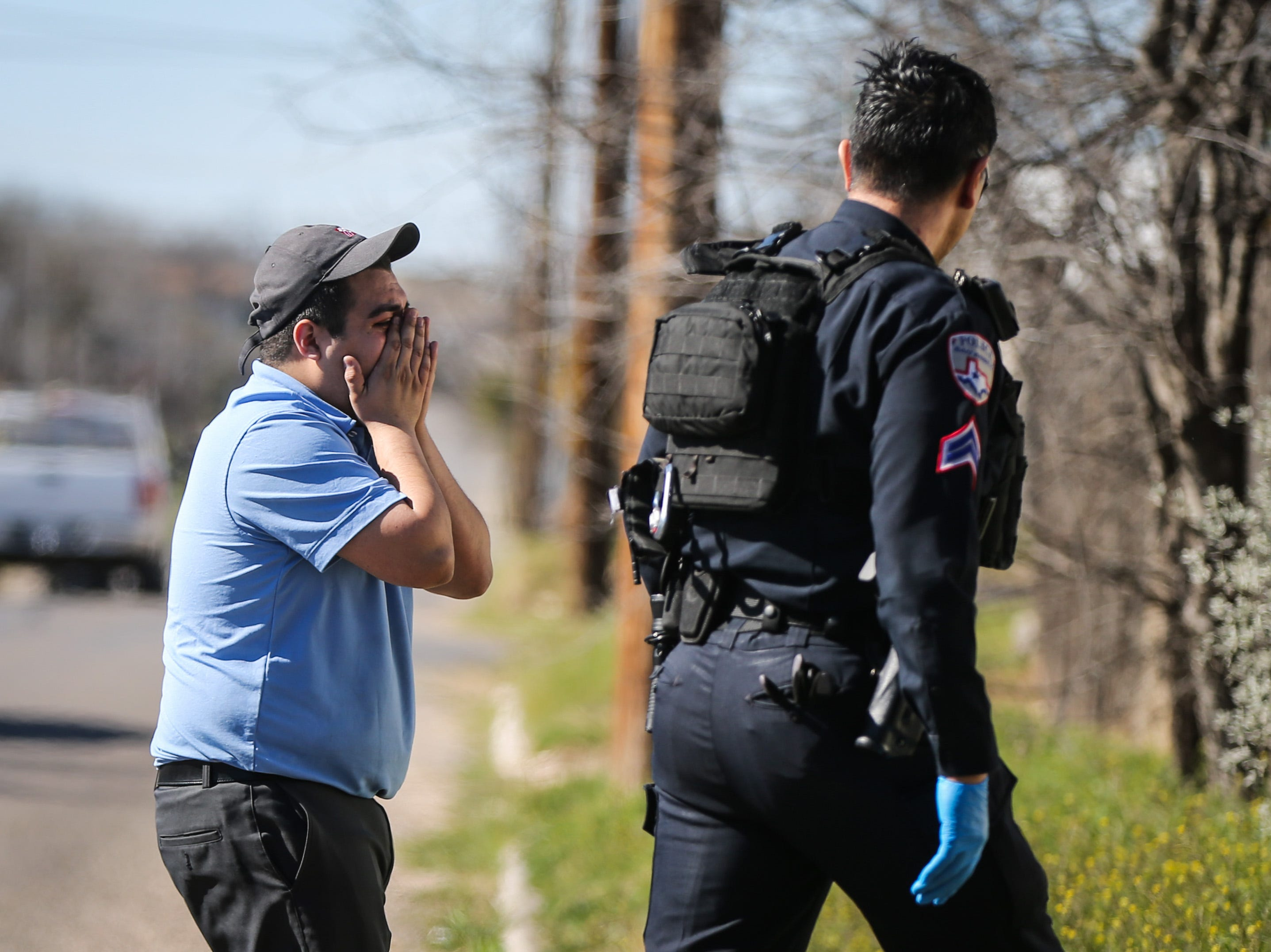 A person reacts at a scene of a fatal shooting Tuesday, March 19, 2019, at 2000 block of Bailey in San Angelo.