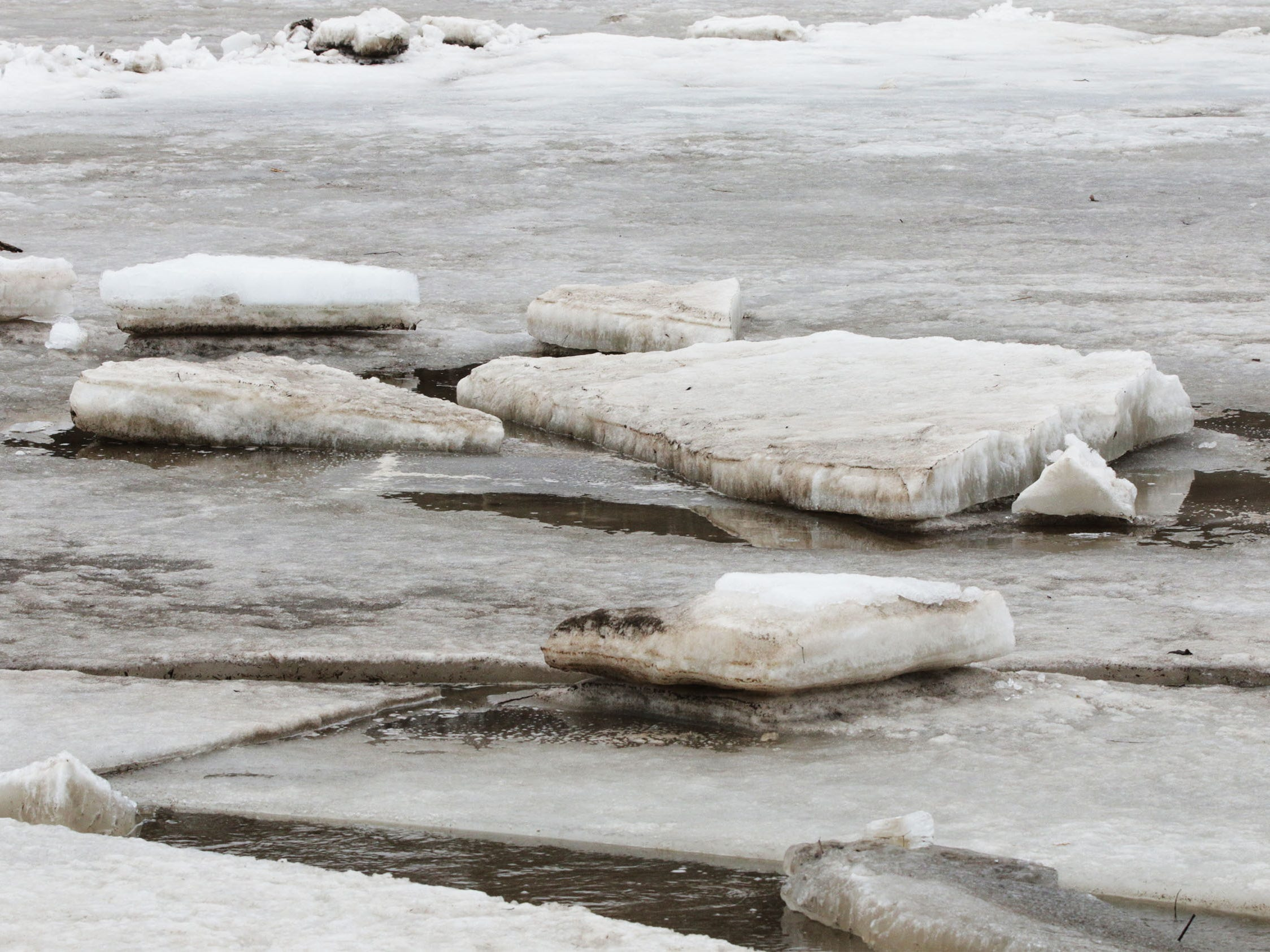 Huge slabs of ice park on top of frozen ice near Kiwanis Park on the Sheboygan River, Wednesday, March 20, 2019, in Sheboygan, Wis. Ice has jammed the area and is expected to flow down river soon.