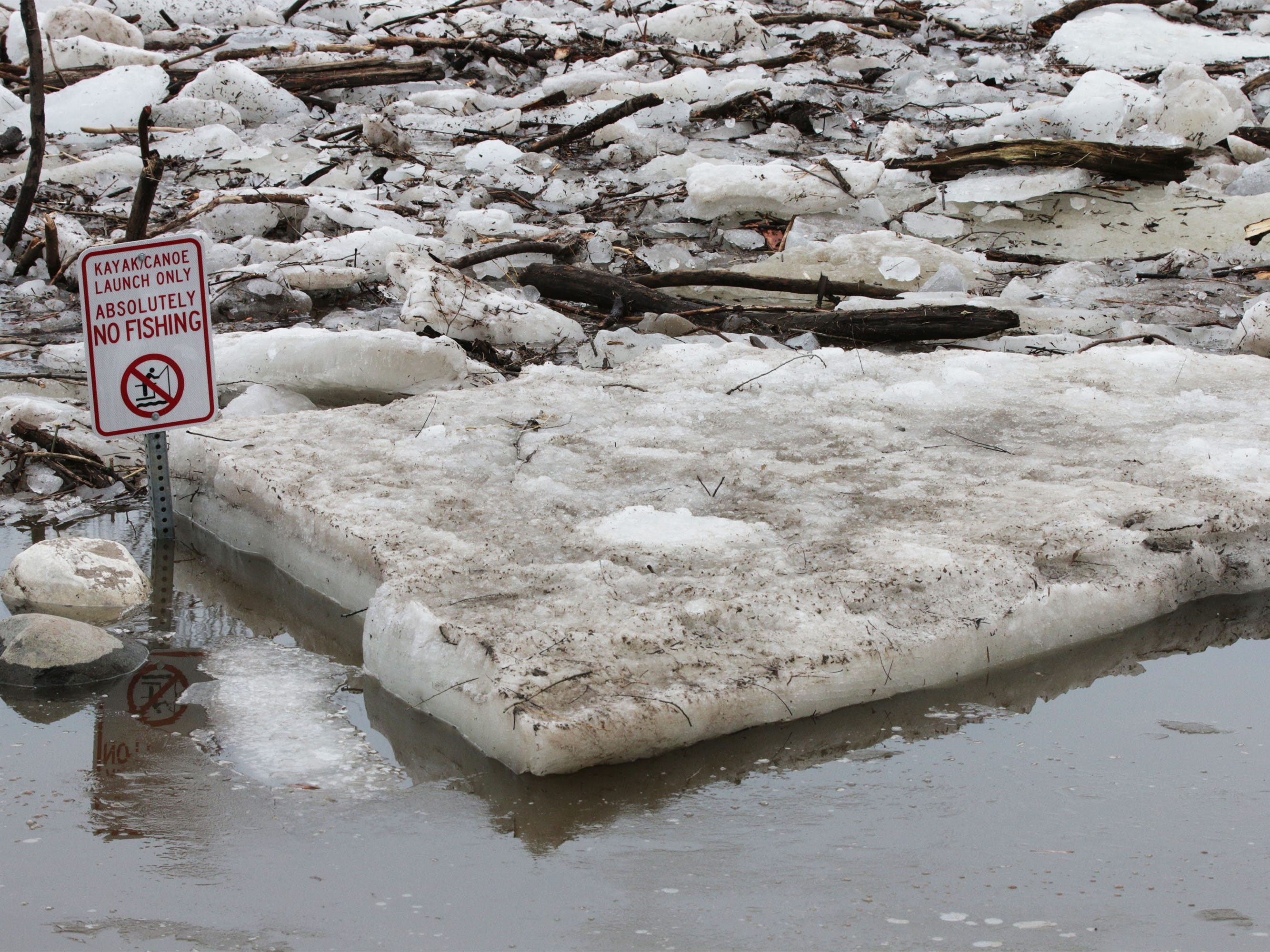 A big slab of ice parks next to a kayak/canoe launch spot at Kiwanis Park, Wednesday, March 20, 2019, in Sheboygan, Wis.