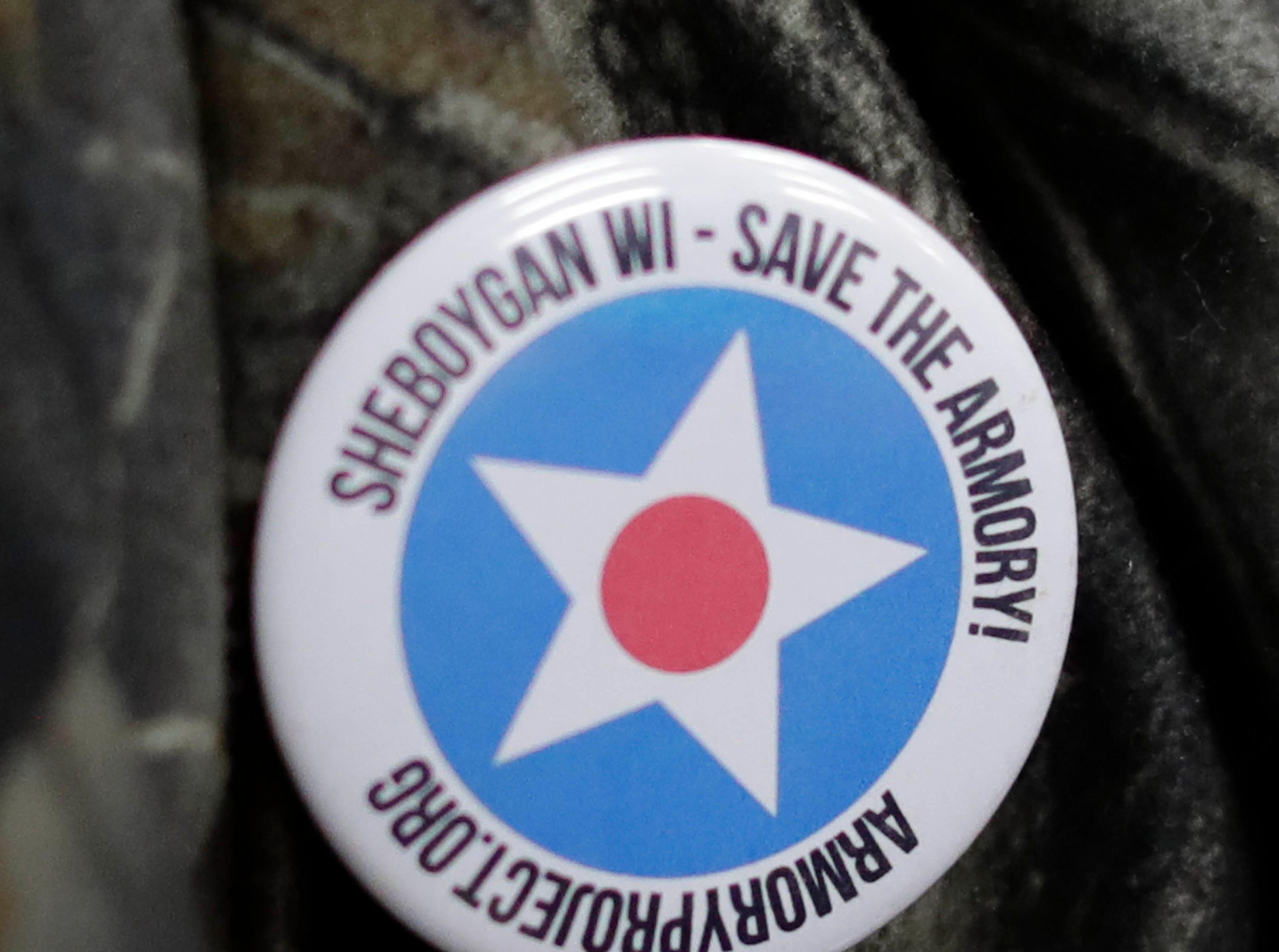 A button was seen during a meeting supporting the Amroy proposals to save the building, Tuesday, March 19, 2019, in Sheboygan, Wis.