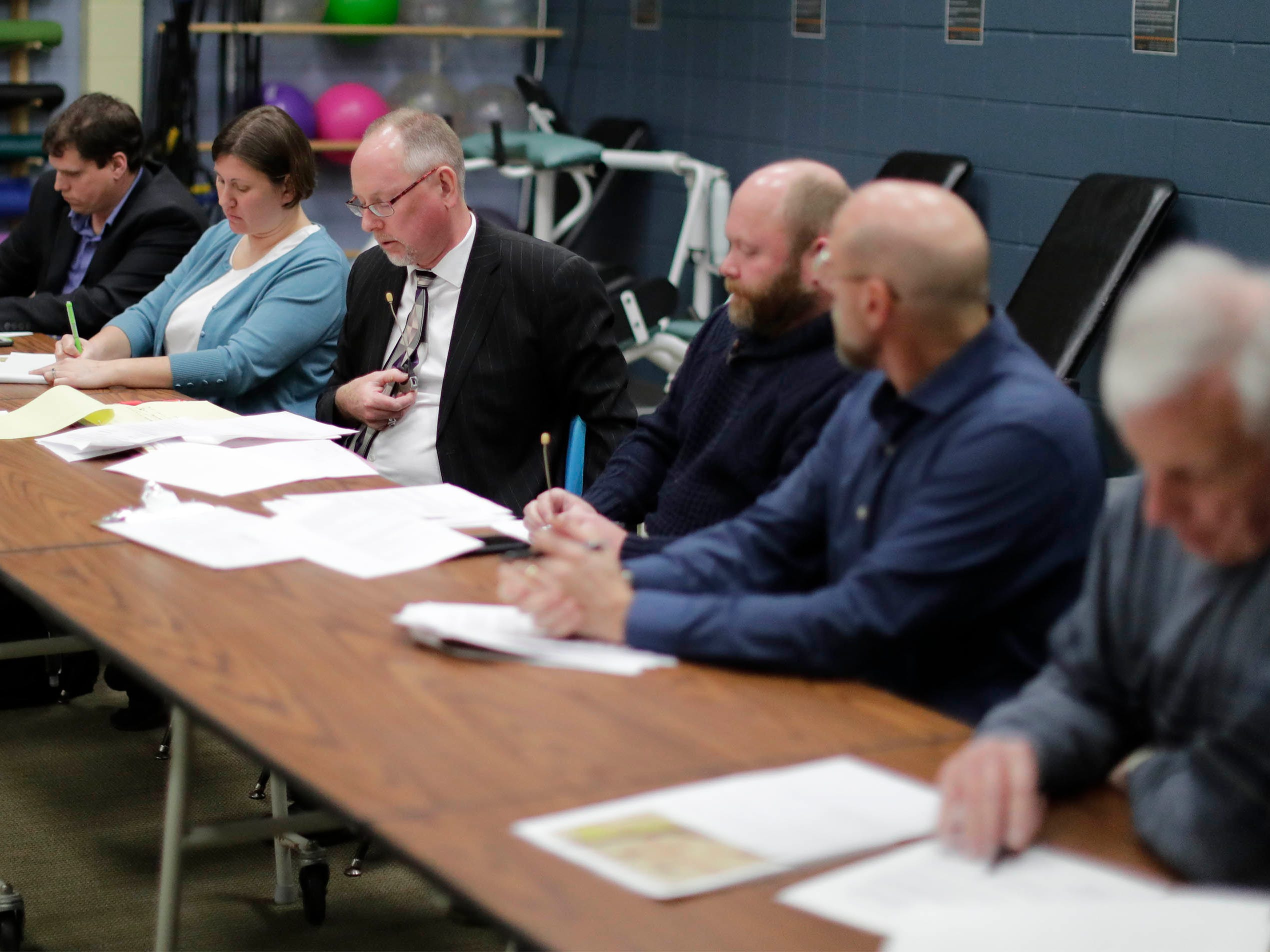 Members of the Historic Preservation Commission seated at the table during a meeting which gave the backers of the building 90 days to get its plans off the ground, Tuesday, March 19, 2019, in Sheboygan, Wis.
