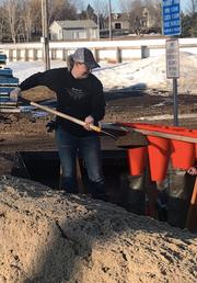 Jennifer Swenson fills sandbags in Brandon on March 19, 2019.