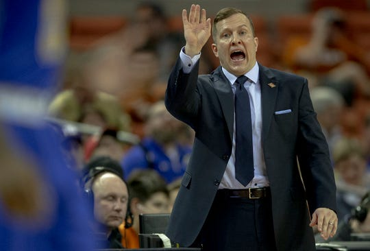 South Dakota State head coach T.J. Otzelberger yells to his team during a first round game against Texas in the NCAA college basketball National Invitation Tournament in Austin, Texas, Tuesday, March 19, 2019. Texas won, 79-73. (Nick Wagner/Austin American-Statesman via AP)