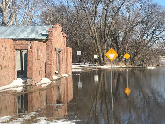 The Dell Rapids bathhouse in city park has been overtaken by the Big Sioux River on March 19, 2019.