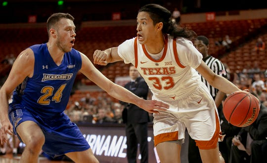 Texas forward Kamaka Hepa (33) drives against South Dakota State forward Mike Daum (24) during a first round game of the NCAA college basketball National Invitation Tournament in Austin, Texas, Tuesday, March 19, 2019.