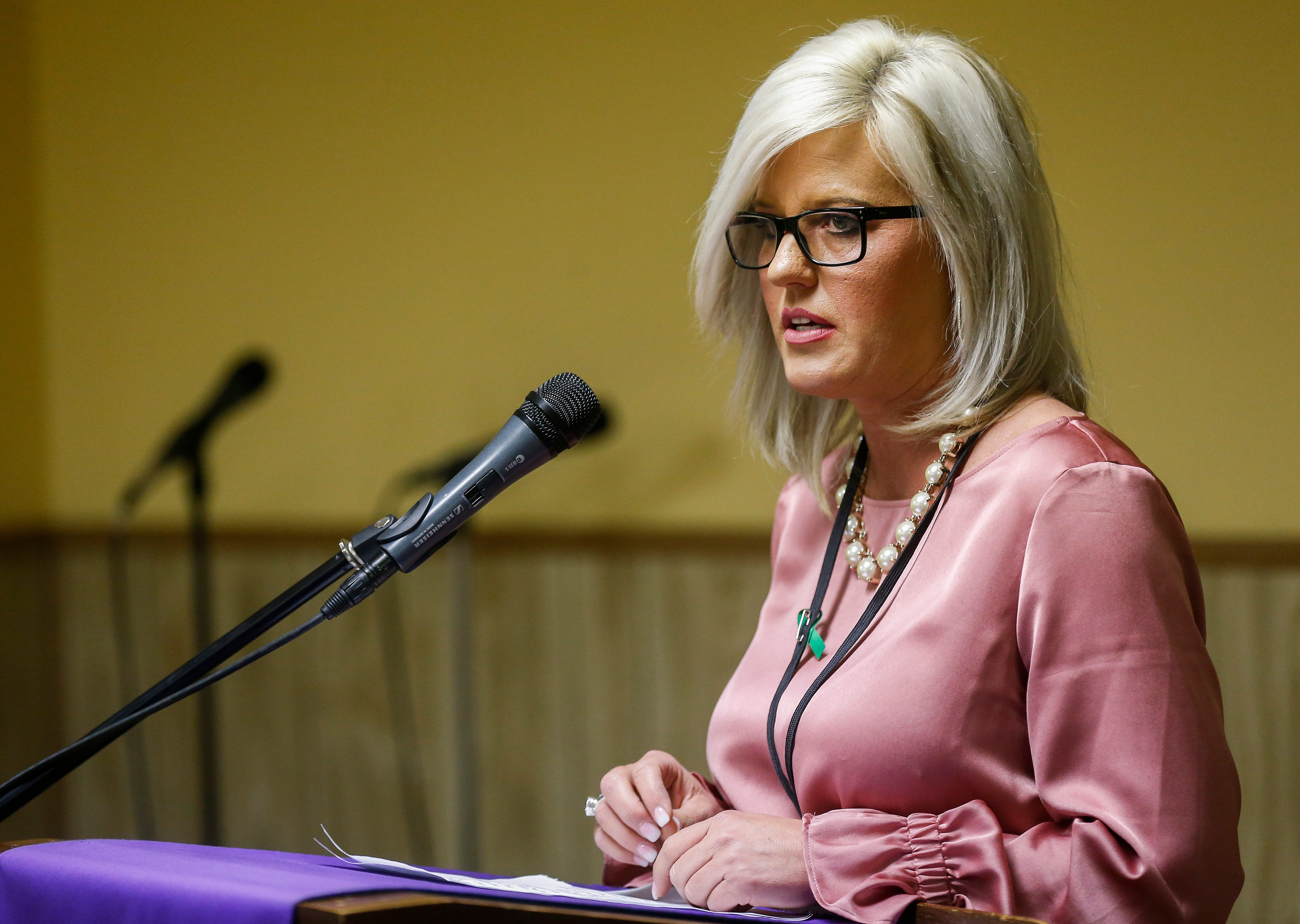 Stephanie Appleby, of NAMI, speaks during a press conference at Pitts Chapel United Methodist Church on Wednesday, March 20, 2019.