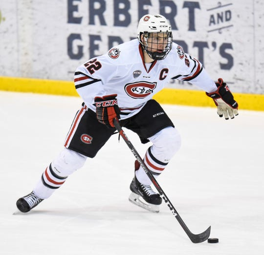 St. Cloud State's Jimmy Schuldt advances with the puck during the first period of the Friday, Feb. 8, 2019, game at the Herb Brooks National Hockey Center in St. Cloud.