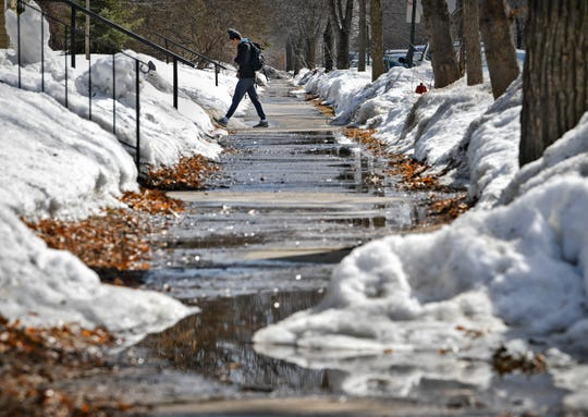 Piles of snow melt slowly onto the streets and sidewalks under warm afternoon sunshine Wednesday, March 20, in St. Cloud. St. Cloud had 52.7 inches of snow for the winter season, according to St Cloud State meteorology professor Bob Weisman. Wednesday was the first day of spring.