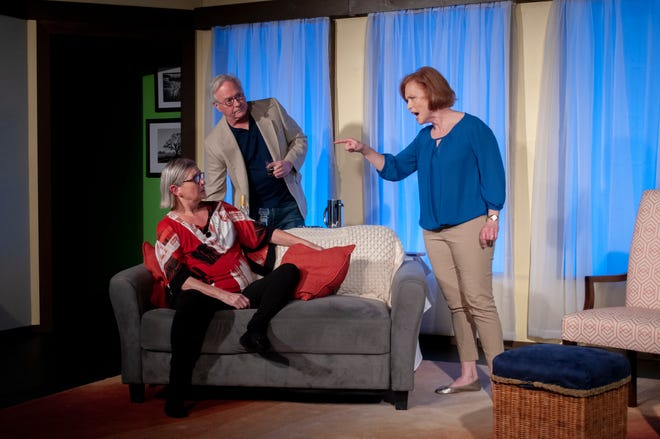 Polly (Dorothea Syleos, right) confronts her sister, Silda (Marlene Dubois), while Polly's husband Lyman (Michael Richey) looks on.
