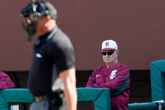 Florida State University Head Baseball Coach Mike Martin watches from the dugout during a game between FSU and Florida International University at Dick Howser Stadium Wednesday, March 20, 2019.